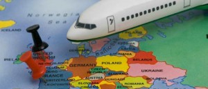 Travel concept, airliner, with push pins in european destinations and a map of the world
